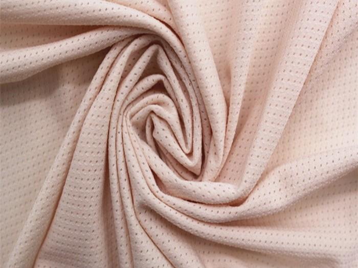 涤纶弹力针织面料 吸湿透气提花针织单面布